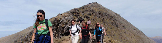A small group of walkers descending the South Ridge, Mount Snowdon